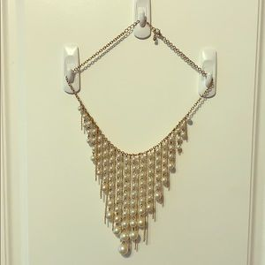 Costume pearl and gold necklace
